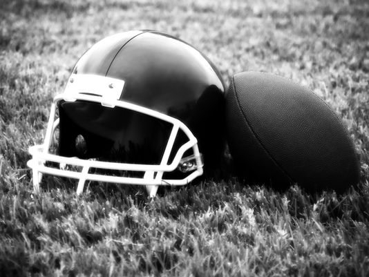 1385135708000-Football-on-helmet-at-field-1