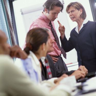 businesswoman-scolding-man-in-meeting_web